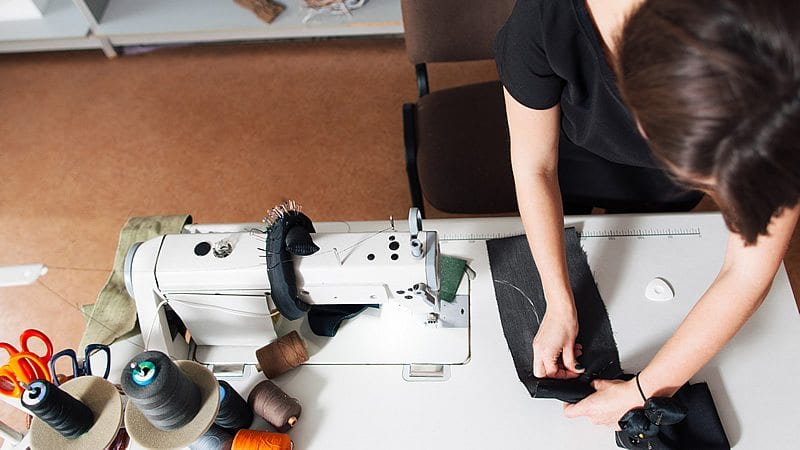 A person using a sewing machine